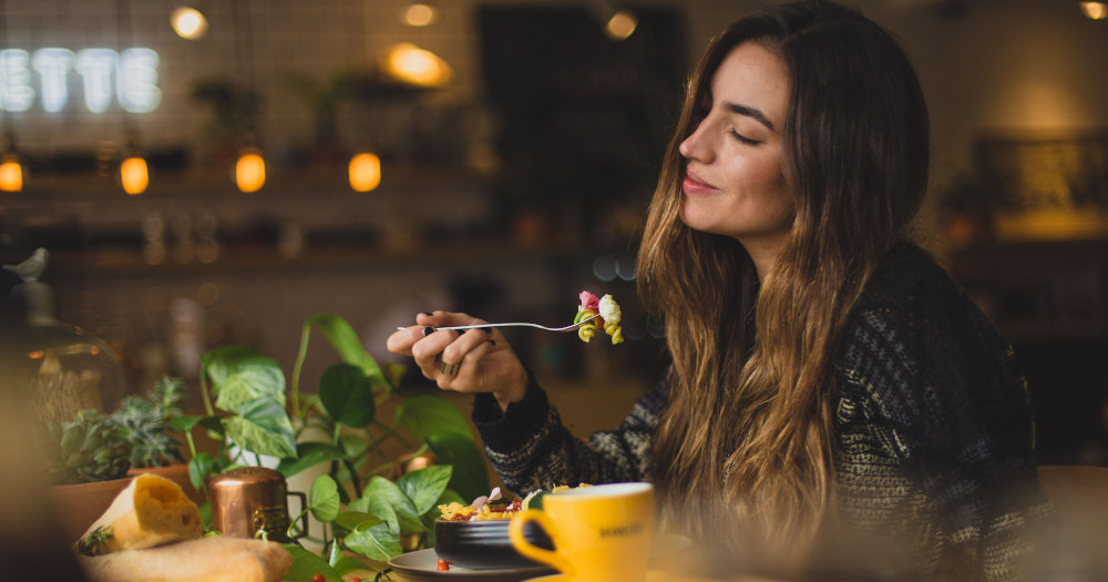 Woman enjoying plant-based foods.