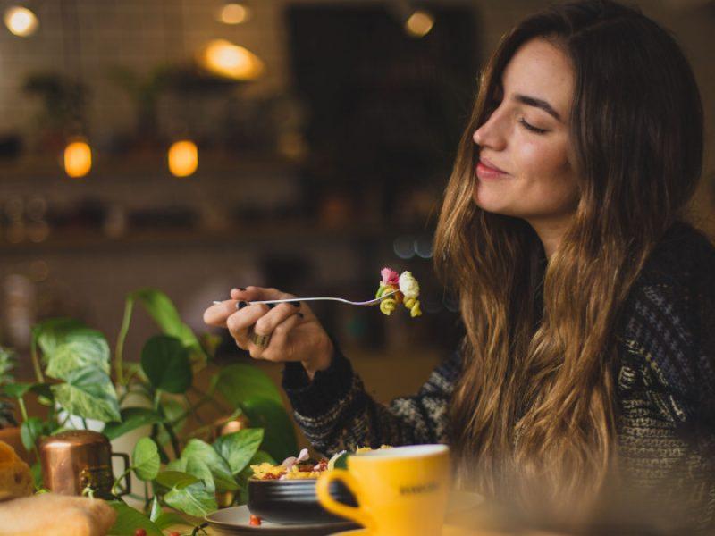 Woman enjoying plant-based foods.